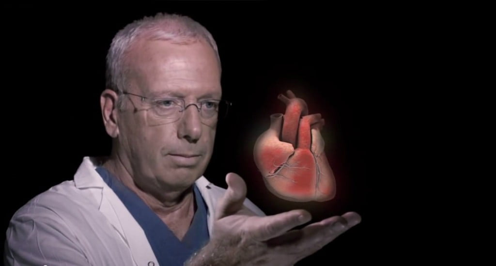 doctor holding 3D holographic heart Real View