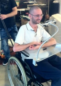 using the device 214x300 Israeli Startup Enables Touch Free Control Of Smart Devices For The Disabled