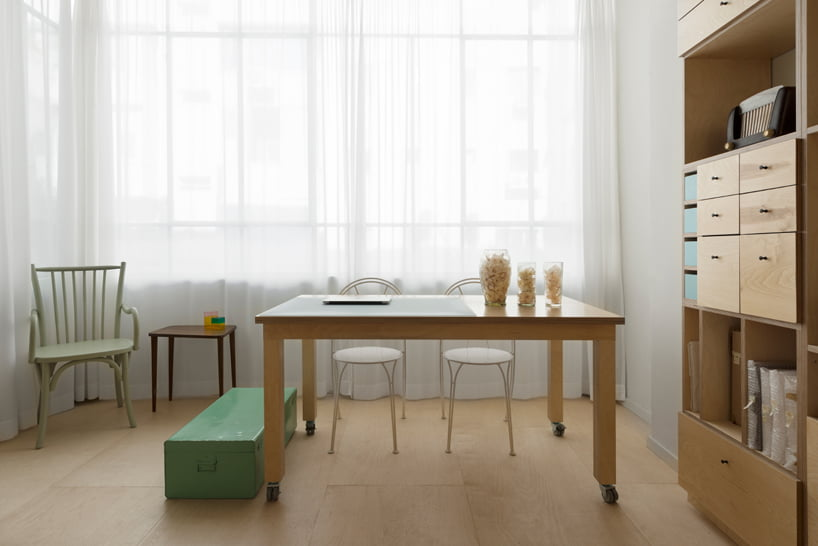 table Israeli Architects Create Tiny Artist Studio That Doubles As Living Space
