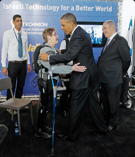 barack obama with a woman wearing the rewalk biosuit