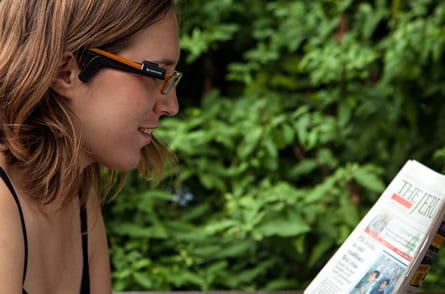 woman wearing orcam glasses