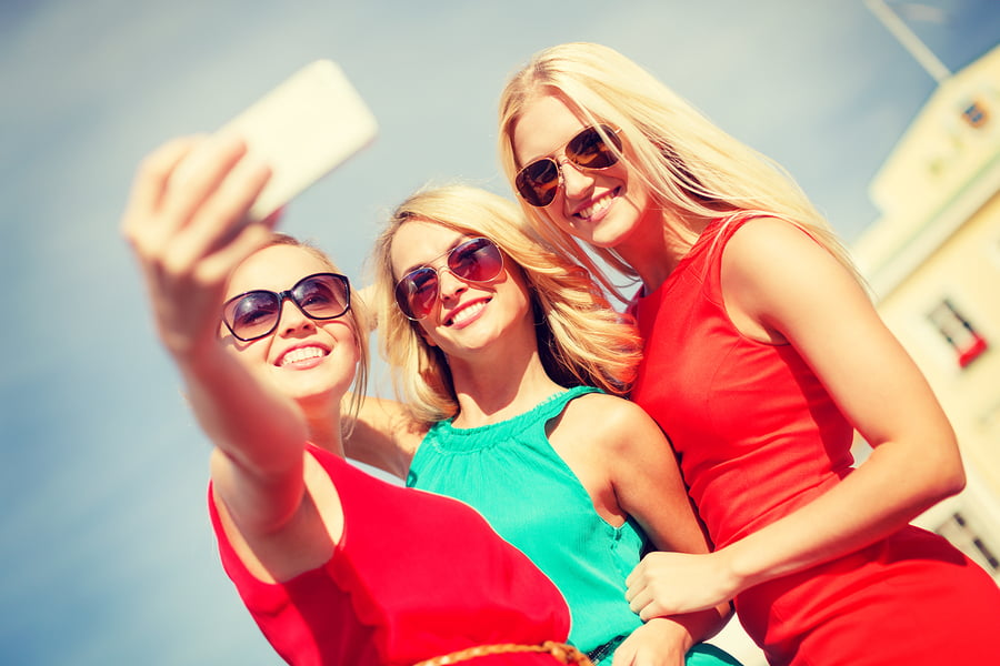 Young women with smartphone camera