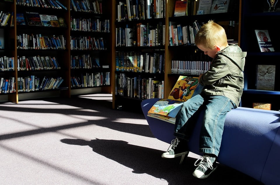 kid in school library