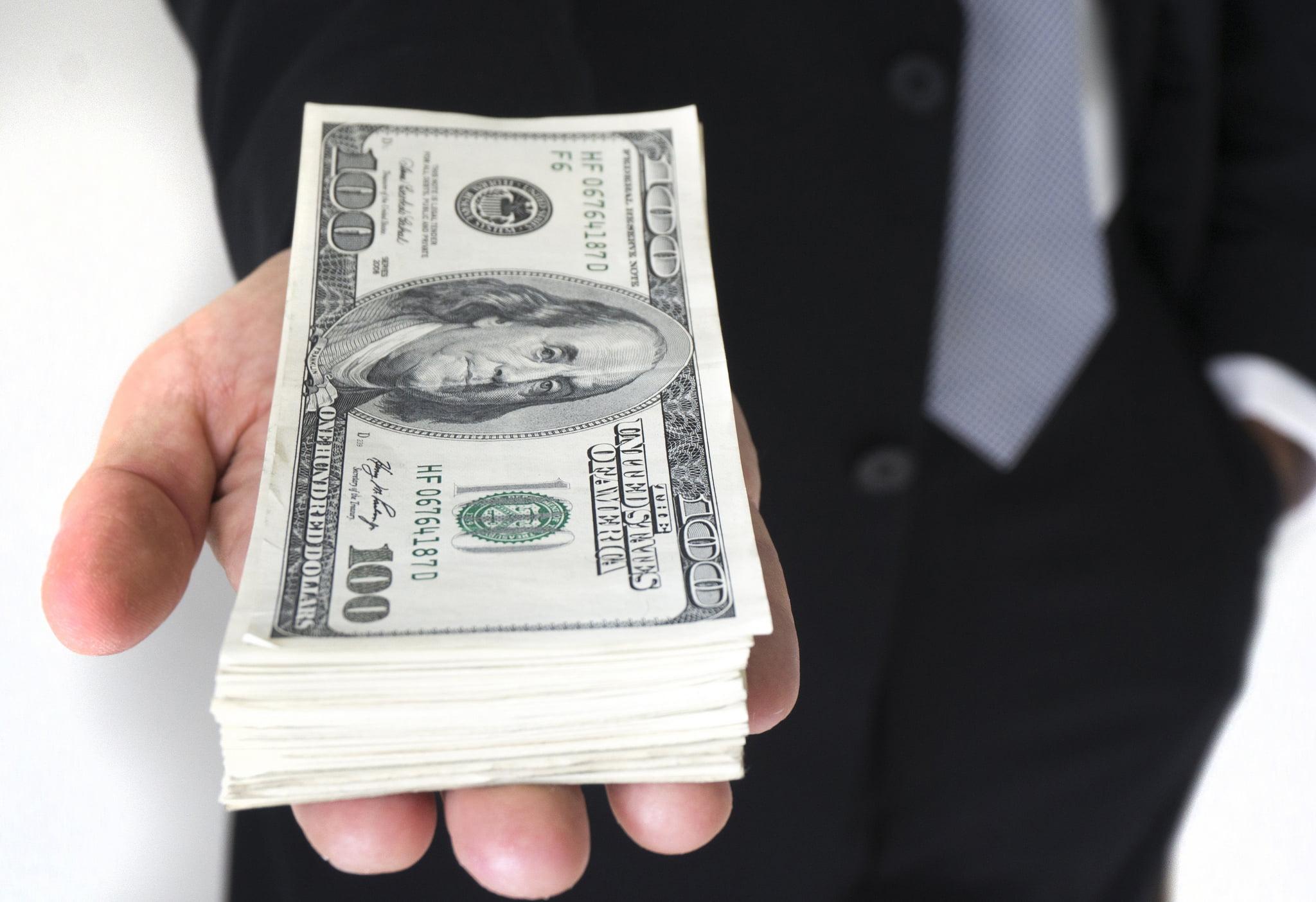 Money in Hand via Flickr