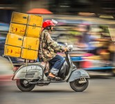 delivery motorcycle on demand packages parcels traffic