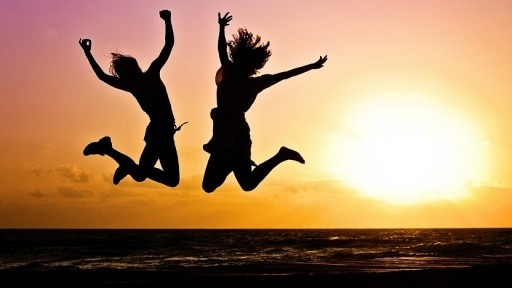 happy young people jump beach