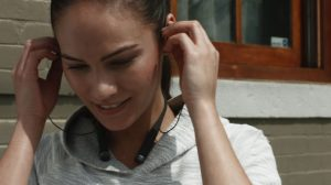 Woman with VI Headphones. Courtesy of LifeBEAM