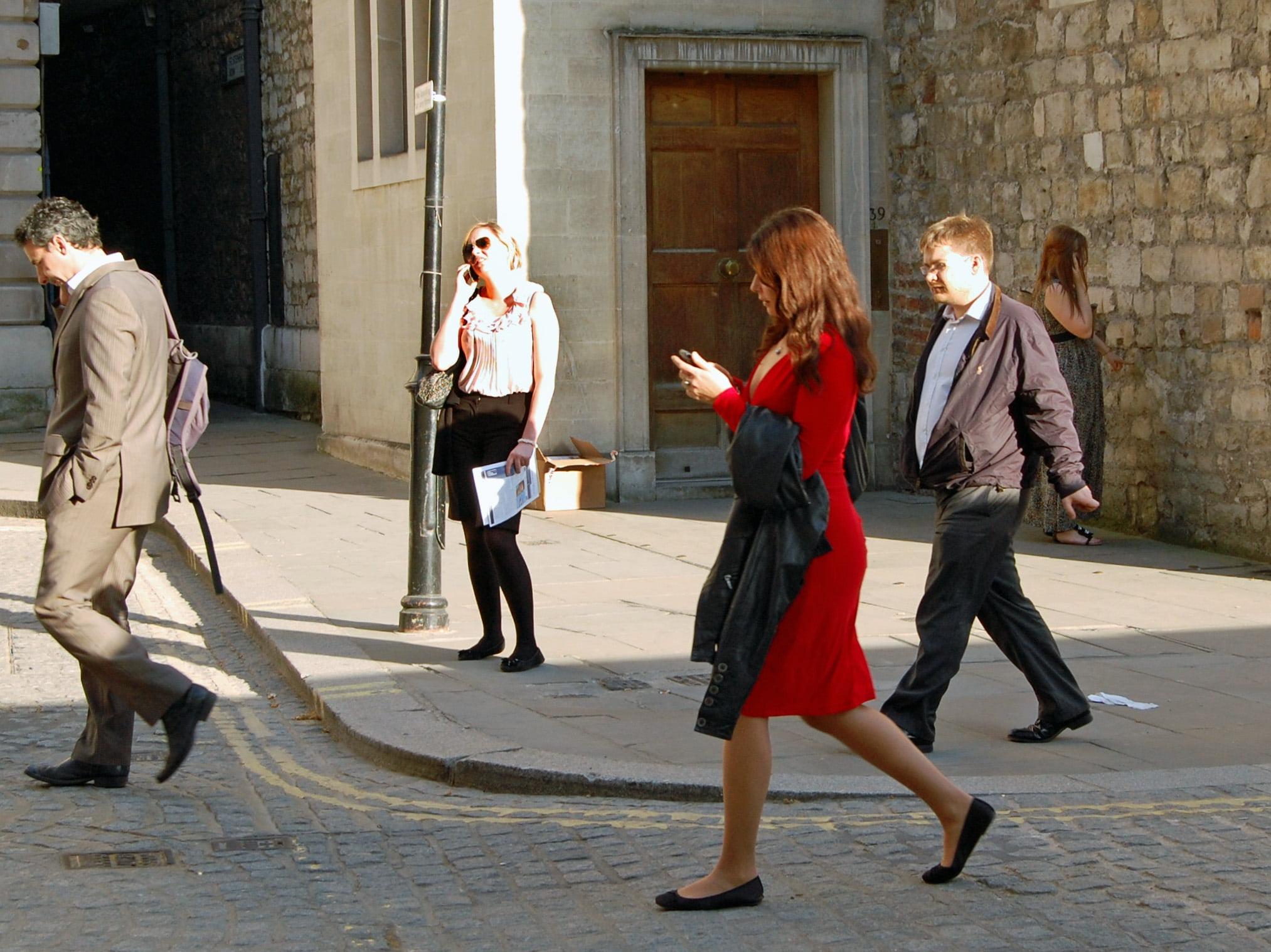 smartphone users crossing street