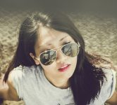 young Chinese woman with sunglasses