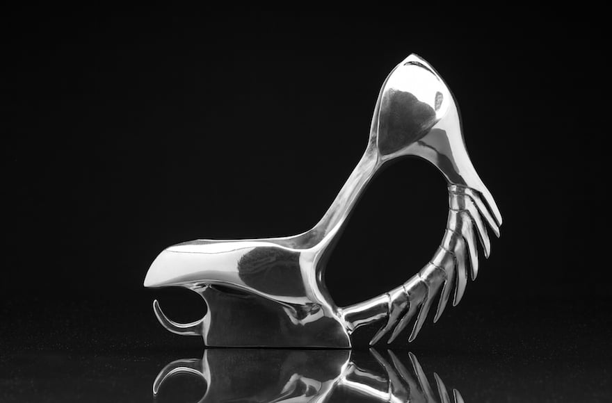 Tzidon crafted this shoe entirely out of aluminum and drew inspiration from motifs found in ancient weapons, such as the armor used by knights in the Middle Ages.