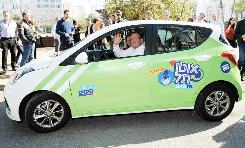 Tel Aviv's mayor and his deputy driving an Auto Tel car. Photo by Kfir Sivan for the City of Tel Aviv