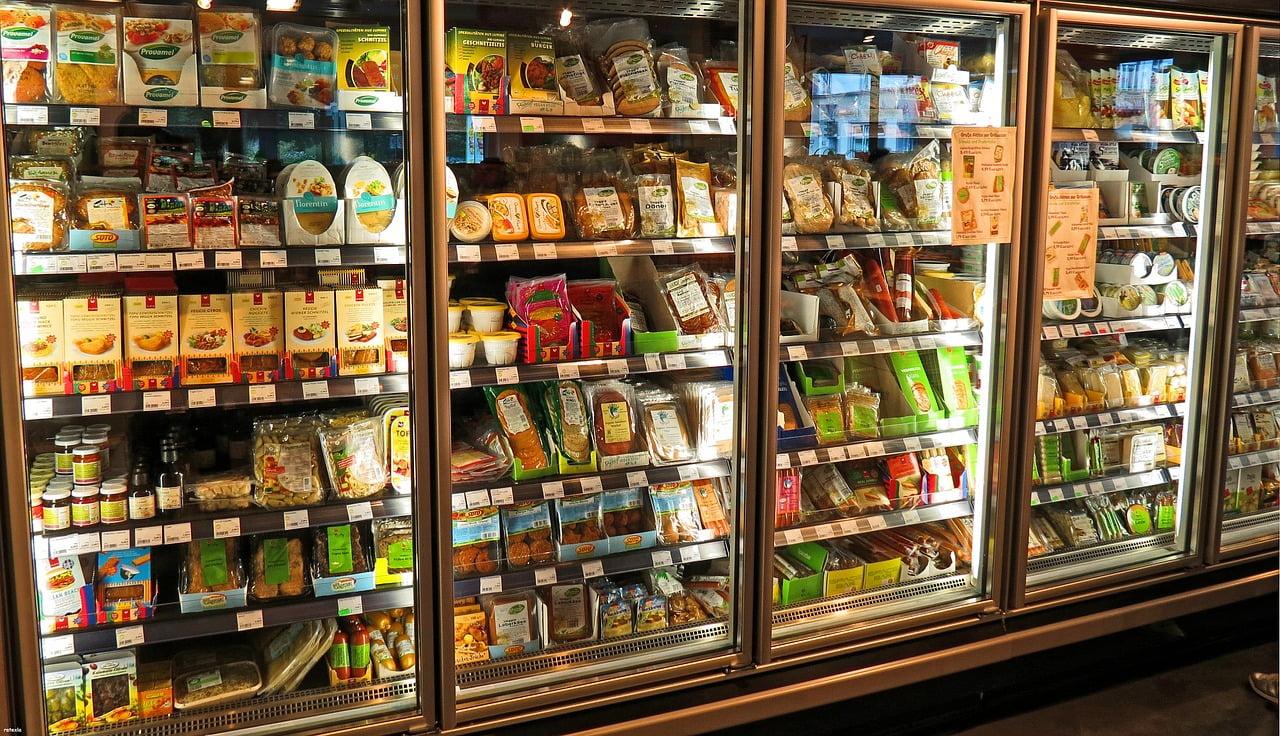 Shopping supermarket produce wraps packaging shelf refrigerator. Courtesy
