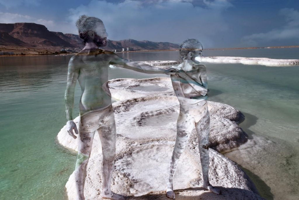 Two of Avi Ram's models in camouflage body paint at the Dead Sea. Courtesy of Avi Ram