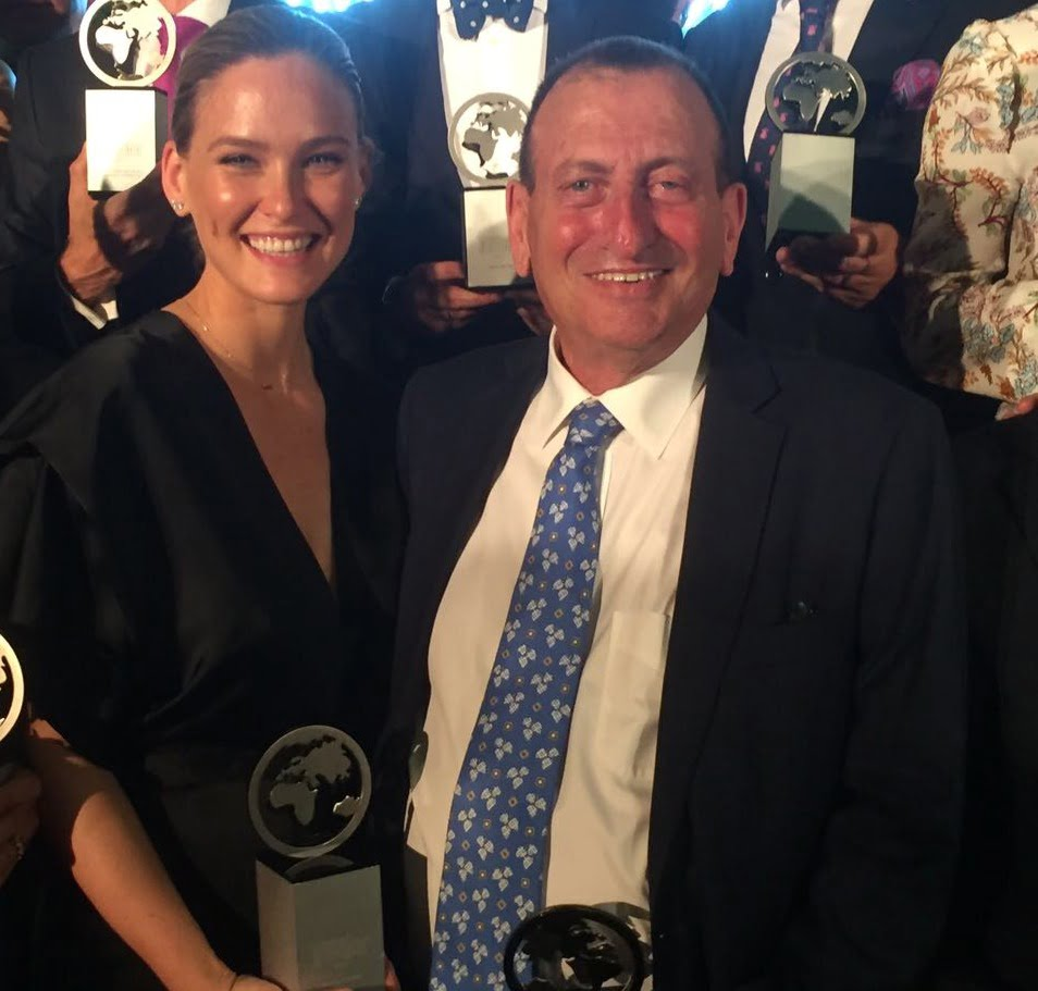 Bar Refaeli and Ron Huldai receiving the award last week. Photo by by Leticia Diaz