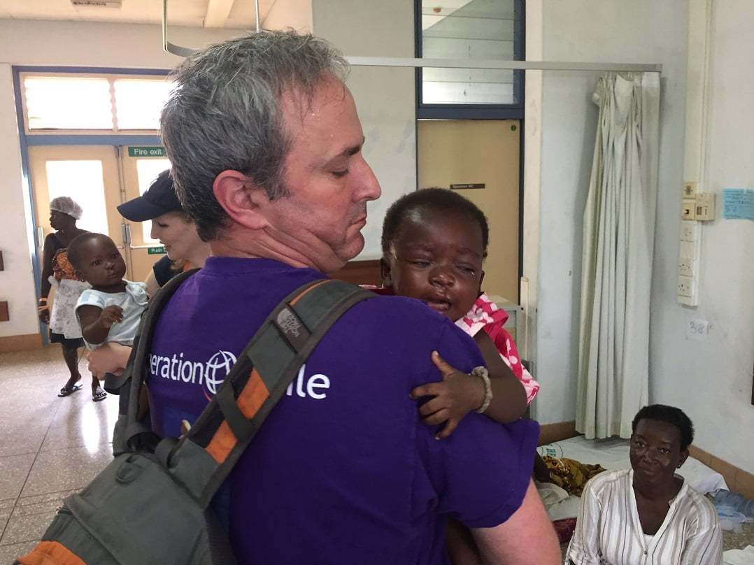Emodi with a patient in Ghana. Courtesy of Rambam Medical Center
