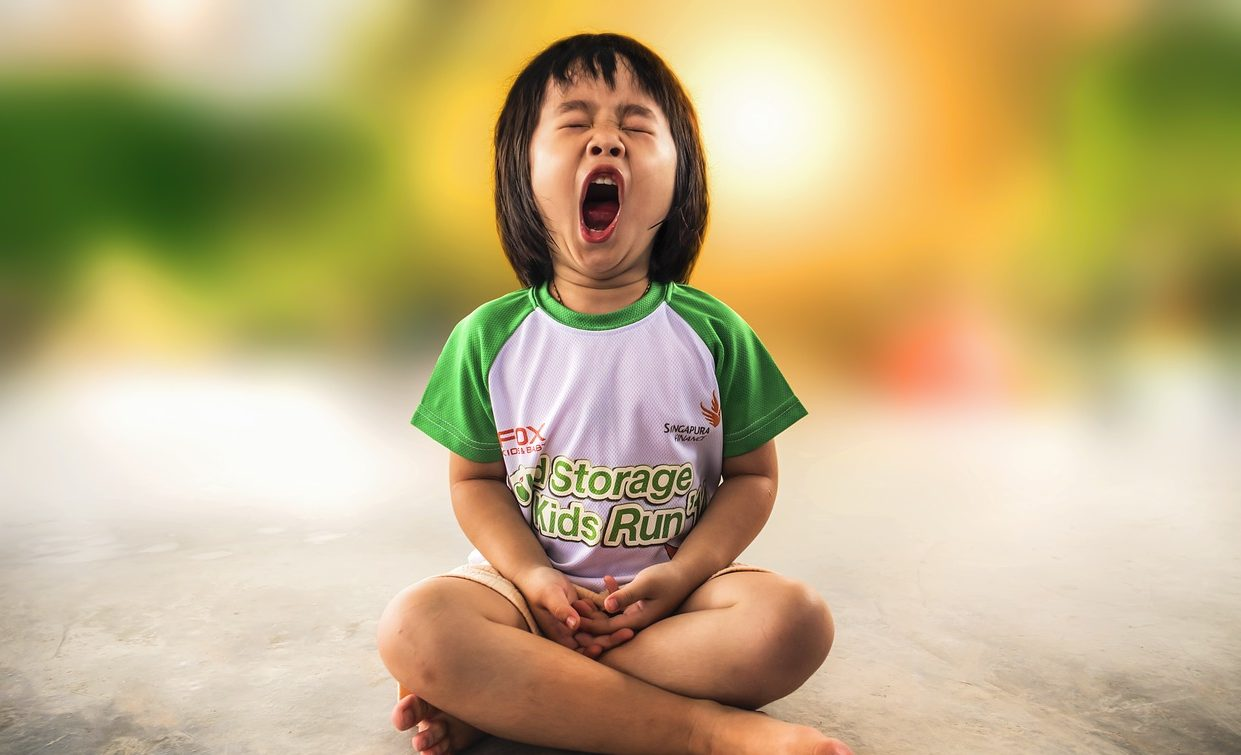 A child yawning via Pixabay
