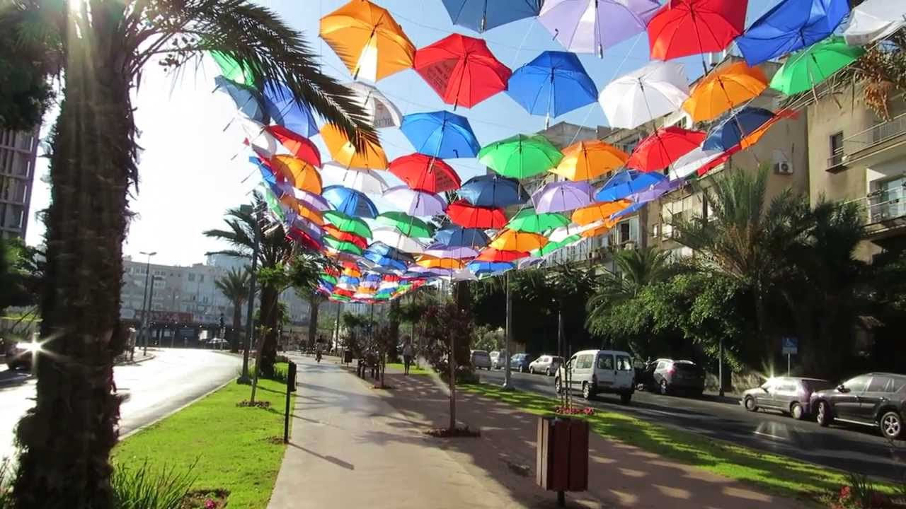 "Six hundred colorful umbrellas once decorated Rothschild Boulevard in a temporary exhibit to announce the ""Wi-Fi cloud"" in 2013. Photo via YouTube."