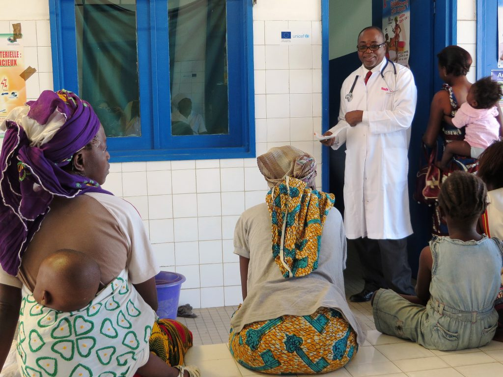 Women and children at a healthcare center in Ivory Coast. EC/ECHO/Anouk Delafortrie via Flickr