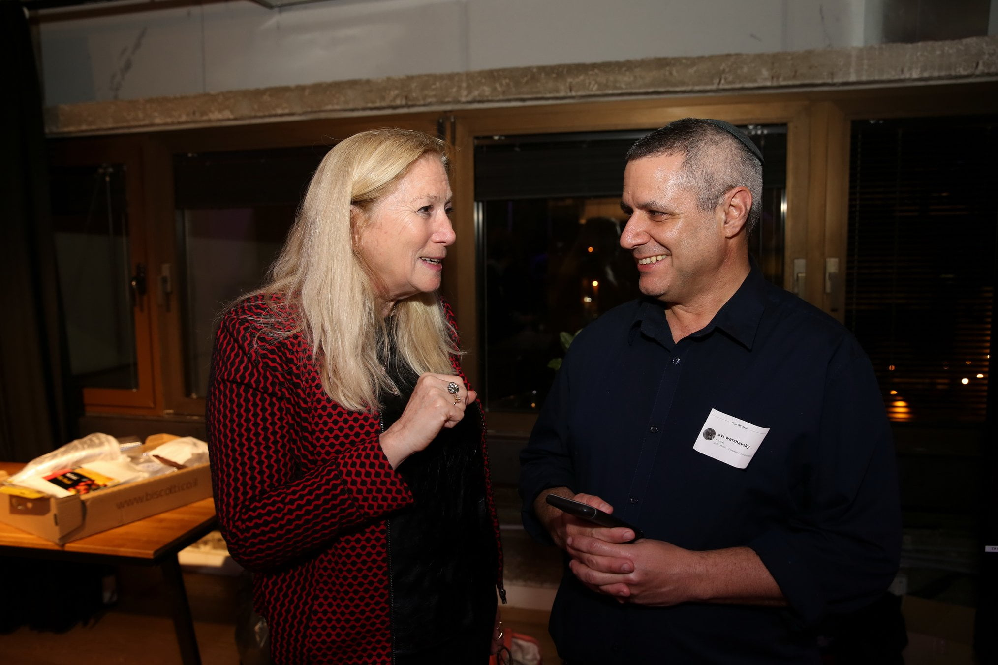 The Israeli Innovation Authority's VP, Startup Division Anya Eldan speaks with MindCET CEO Avi Warshavsky before the start of the Demo Day pitches. Photo by Eliran Avital.
