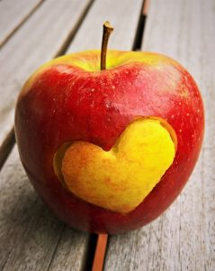An apple with a heart. Photo by Pexels