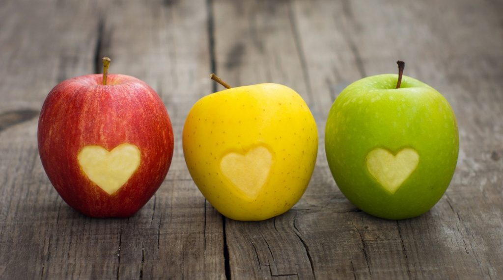 Apples with hearts. Deposit Photos