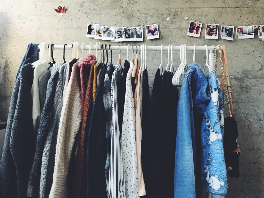 Clothes on a rack. Photo via Unsplash