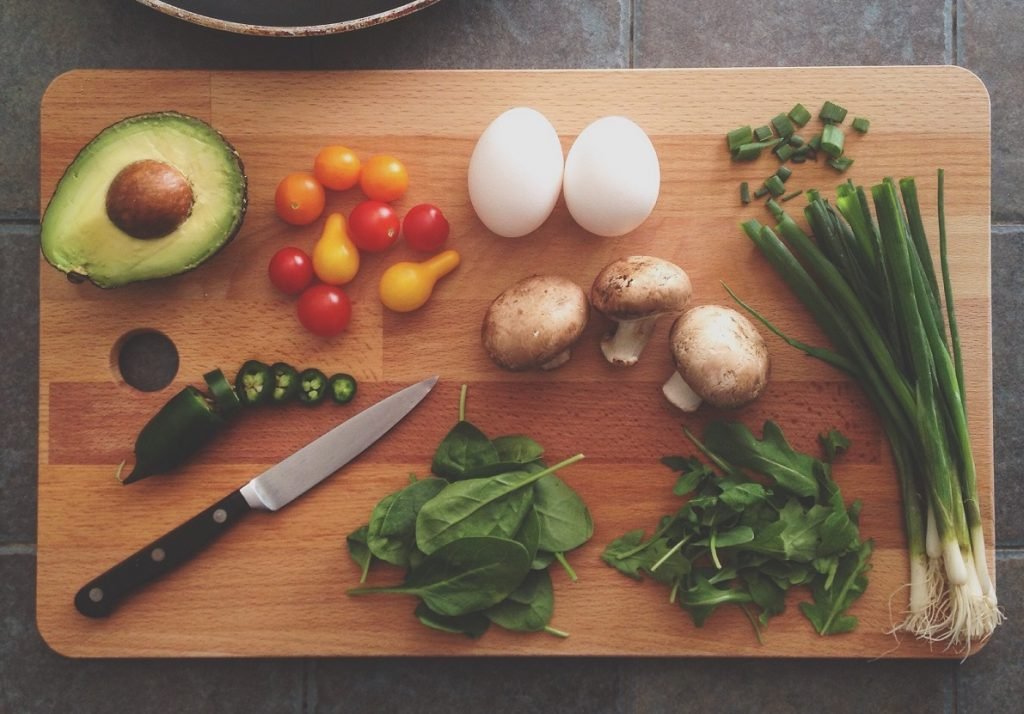 An illustrative photo of vegetables on a chopping board. Unsplash