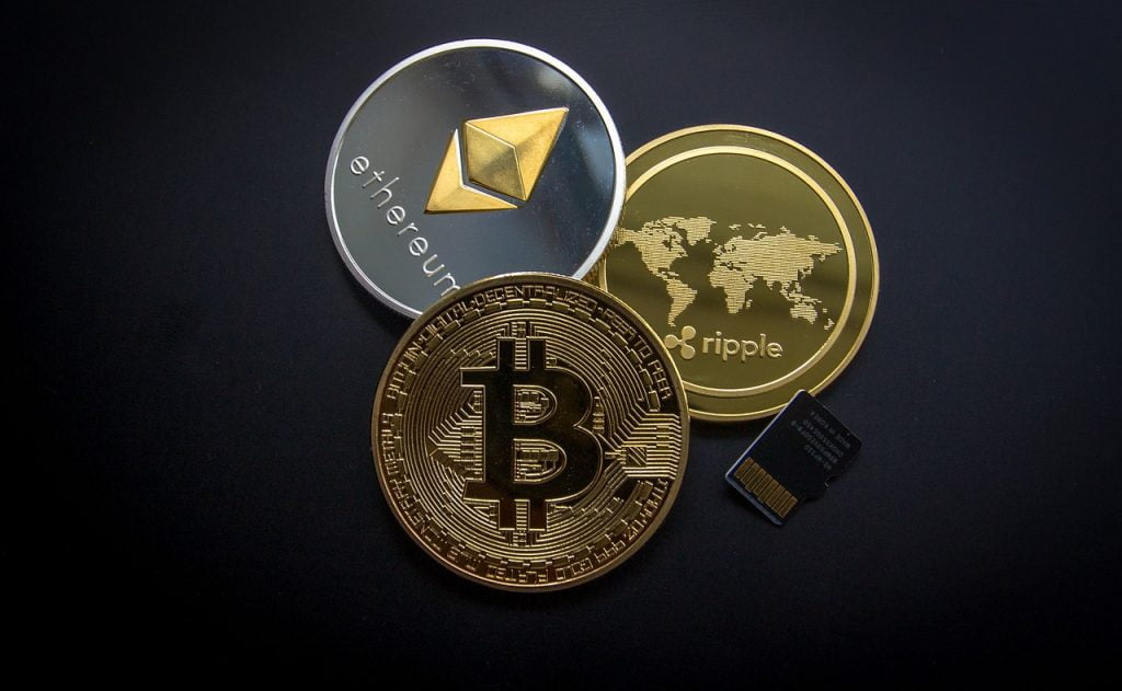 A photo showing virtual coins Bitcoin, Ethereum, Ripple. Pixabay