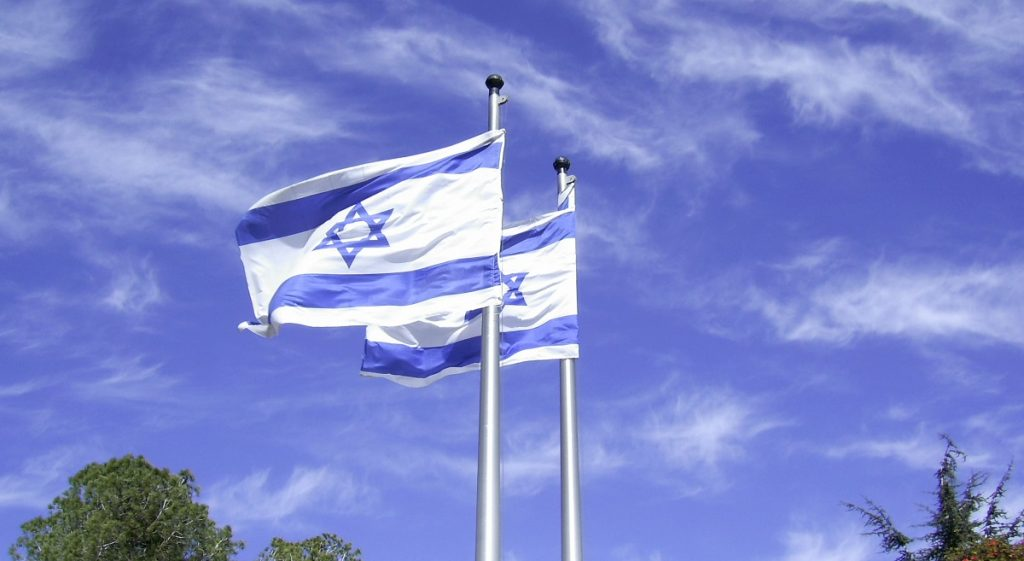 Israeli flags flying. Photo via zeevveez on Flickr, CC BY 2.0