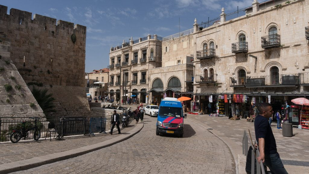 A minibus driving in Jerusalem. Photo by eugene_o via Flickr, CC BY 2.0