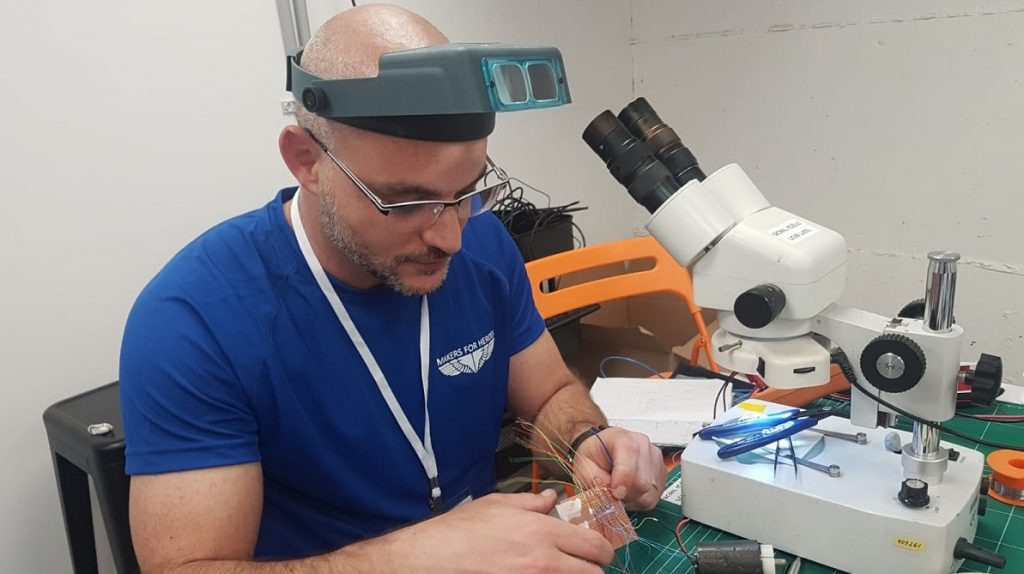 An Israeli professional makes a product for Makers for Heroes, May 2018. Courtesy