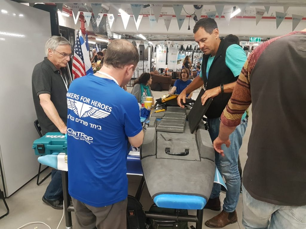 Makers for Heroes create a customized surfboard for Inbal, a soldier injured while serving in the IDF. Courtesy