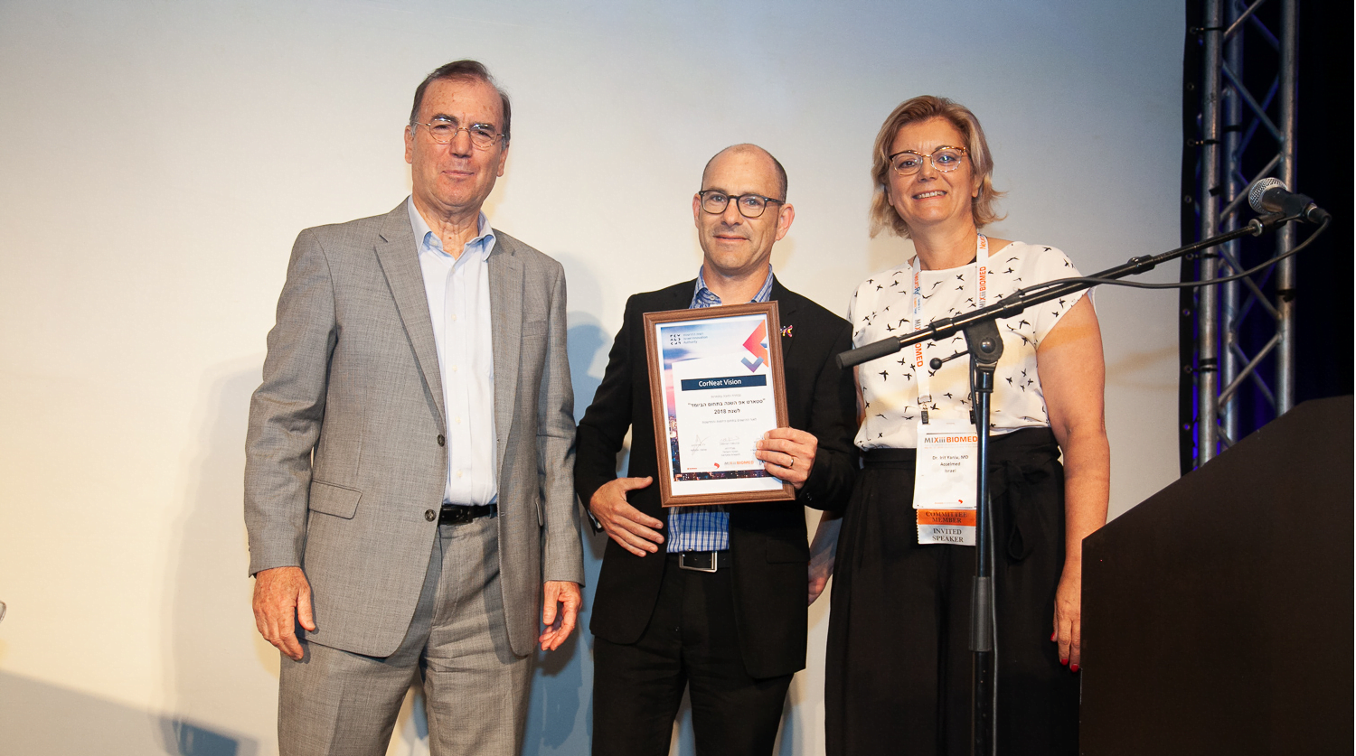 Dr. Ami Appelbaum, chairman of the Israel Innovation Authority (l) and Dr. Irit Yaniv of Accelmed stand with winner Dr. Gilad Litvin chief medical Officer for CorNeat Vision. Photo via Alexander Elman
