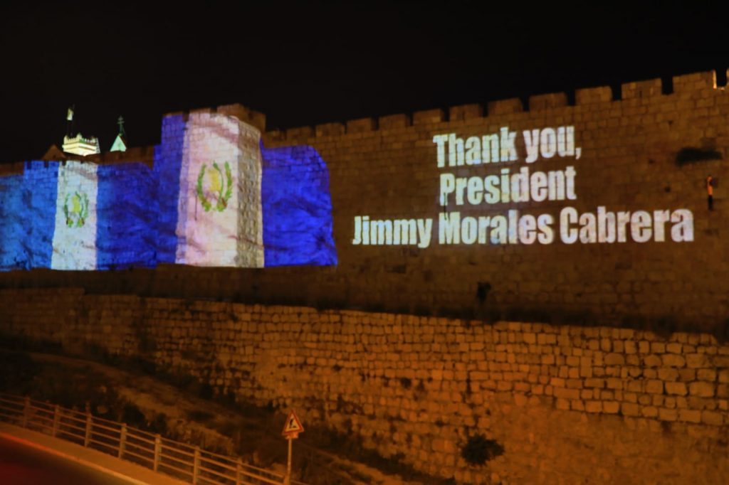 Th walls of the Old City of Jerusalem illuminated with the Guatemalan flag. Photo by Sasson Tiram via the GPO