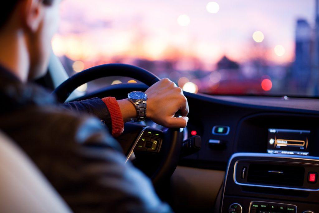 An illustrative photo of a person in a car. Photo via Pixabay