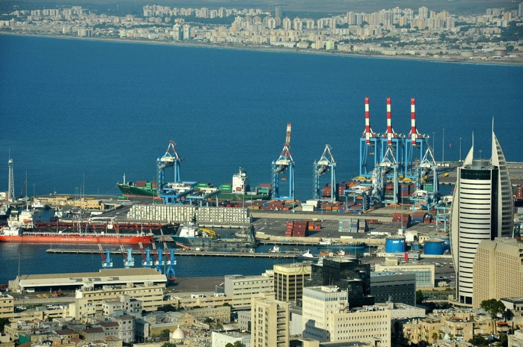 "Haifa Port. Photo by <a href=""https://www.flickr.com/photos/e-licious/8008093691/in/photolist-dcDzfT-Trtwtr-UJnhVi-o2ZcNW-2T3DBh-UJnikr-BSzRY-nKBAYk-4qwwpA-g3az9G-g37uh3-joeRUT-UxJ1E7-oopx1D-4qwvLo-4edB4Q-4CmGxE-nS49kL-dn8MeV-dn8NqR-4CmHEL-dn8Mkg-5cyD3W-246ARSy-2ktkji-4edDeA-dyPj5e-5RpUYb-TrSFWj-5RpPNy-5RpWb9-g336QY-5RpP9h-VTja7m-joeMiZ-jogm2v-25Ed77b-joeT2n-joeLcF-UxJ1Xb-jognSp-LpMjRL-VdpeZe-Vf2gjv-WgXDPX-5Rkxbn-nnnm4Y-5Rkvic-pBigQH-4edEKs"" target=""_blank"" rel=""noopener"">Elaine via Flickr</a>, CC BY 2.0"