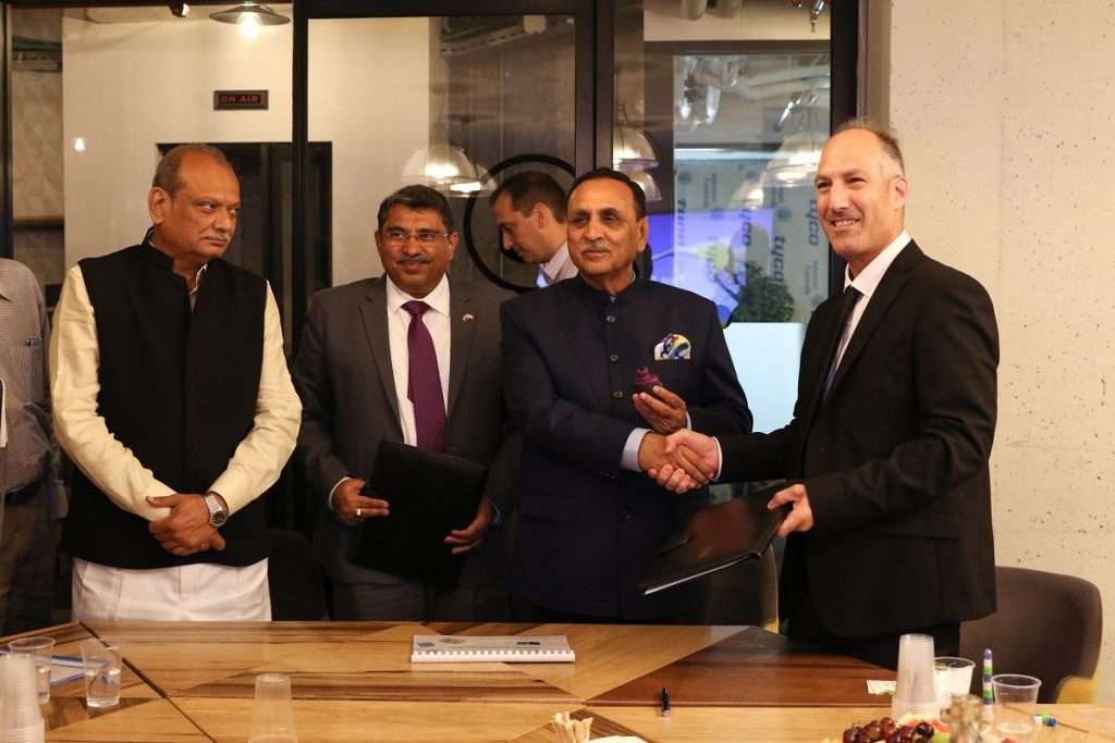 Biofeed's Dr. Nimrod Israely signs an MOU with the chief minister of the Indian state of Gujarat, Vijay Rupani, in July 2018. Courtesy
