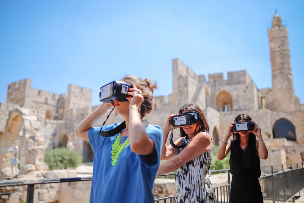 Visitors taking part in the Step Into History VR tours produced by the Tower of David Museum and Lithodomos VR. Photo by Ricky Rachman