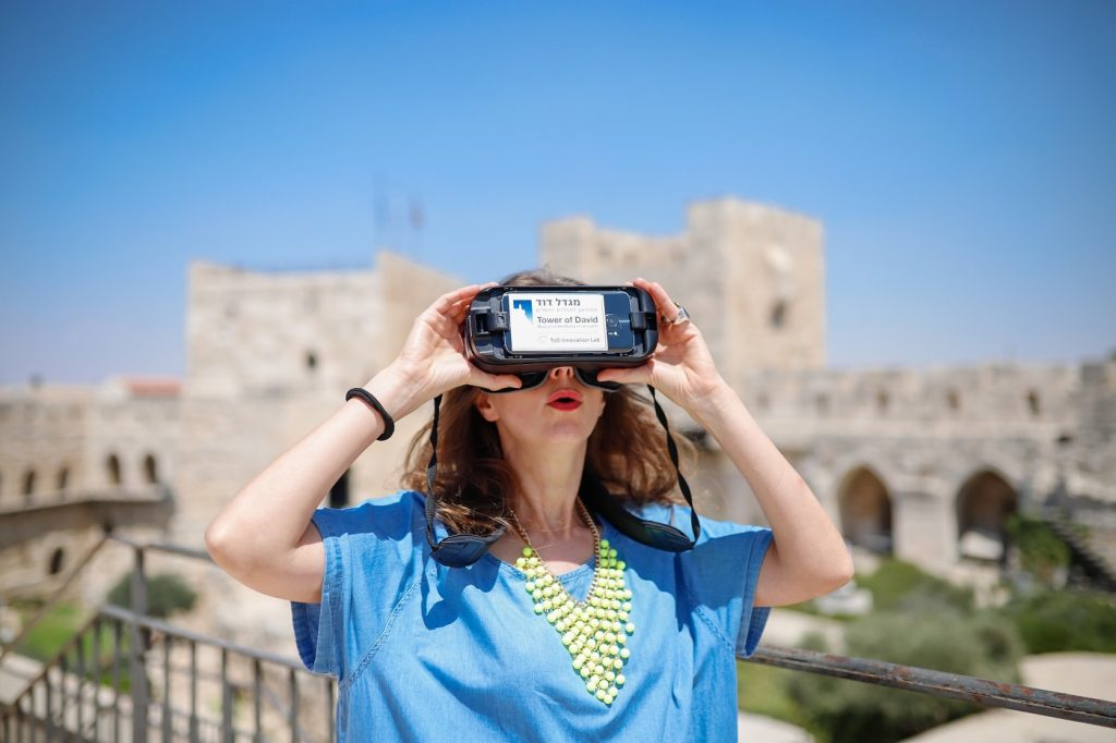 A visitor taking part in the Step Into History VR tours produced by the Tower of David Museum and Lithodomos VR. Photo by Ricky Rachman