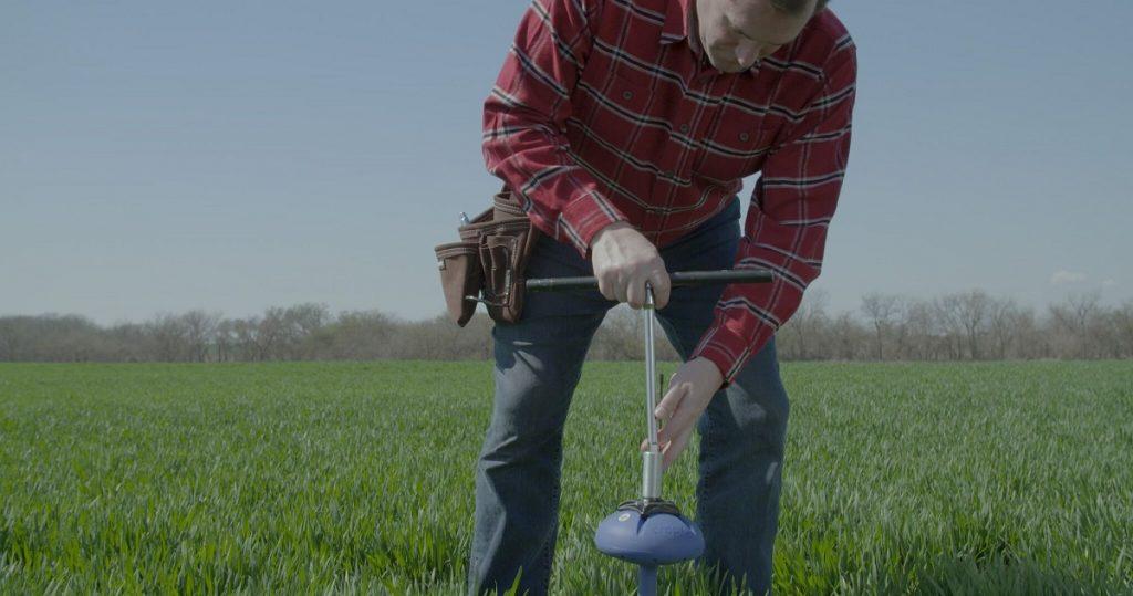 A farmer installs the CropX sensor. Courtesy