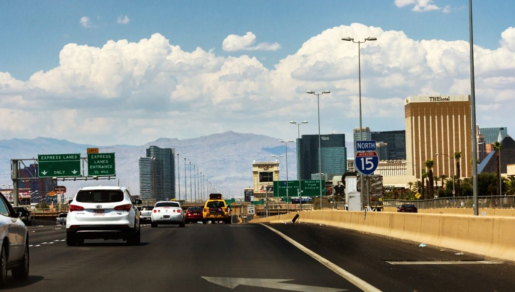 """Crowded Interstate 15 North with a view to the Las Vegas strip. <a href=""""http://dep.ph/v/3zwr6f-bsat0"""" target=""""_blank"""">Deposit Photos</a>"""