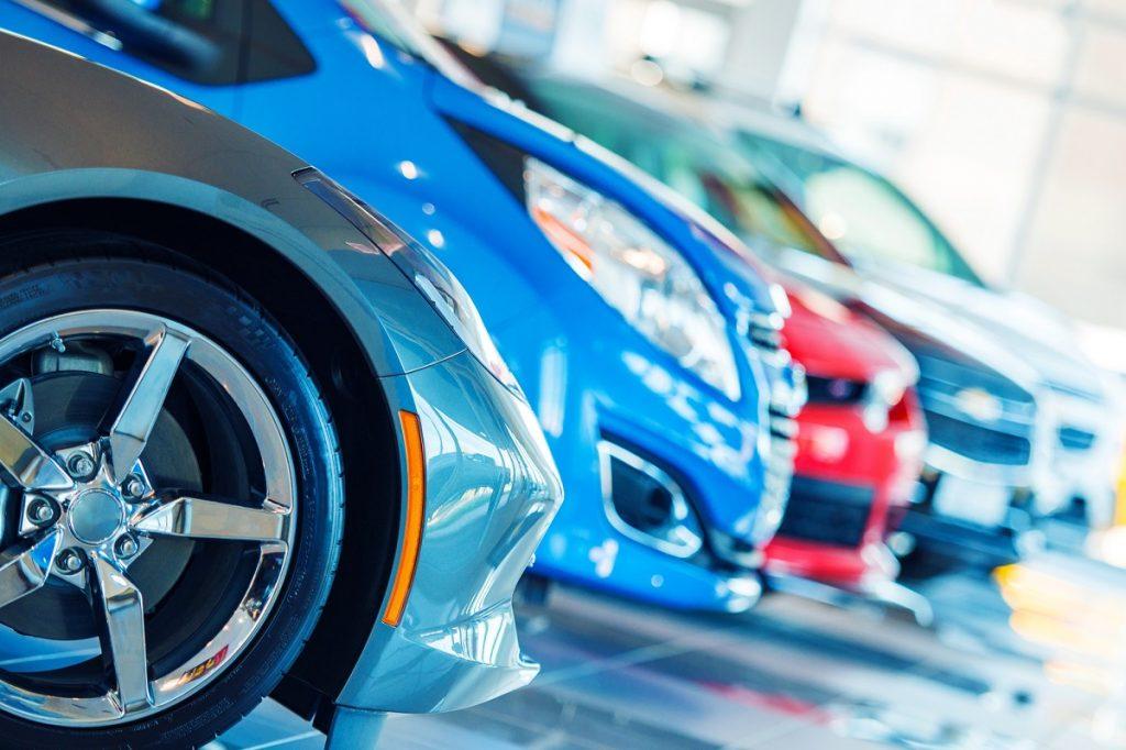 Cars in a showroom. Photo via Deposit Photos