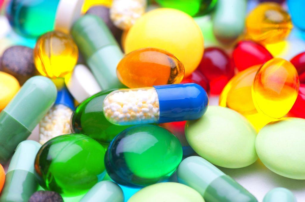 Pills and gel capsules. Photo via Deposit Photos