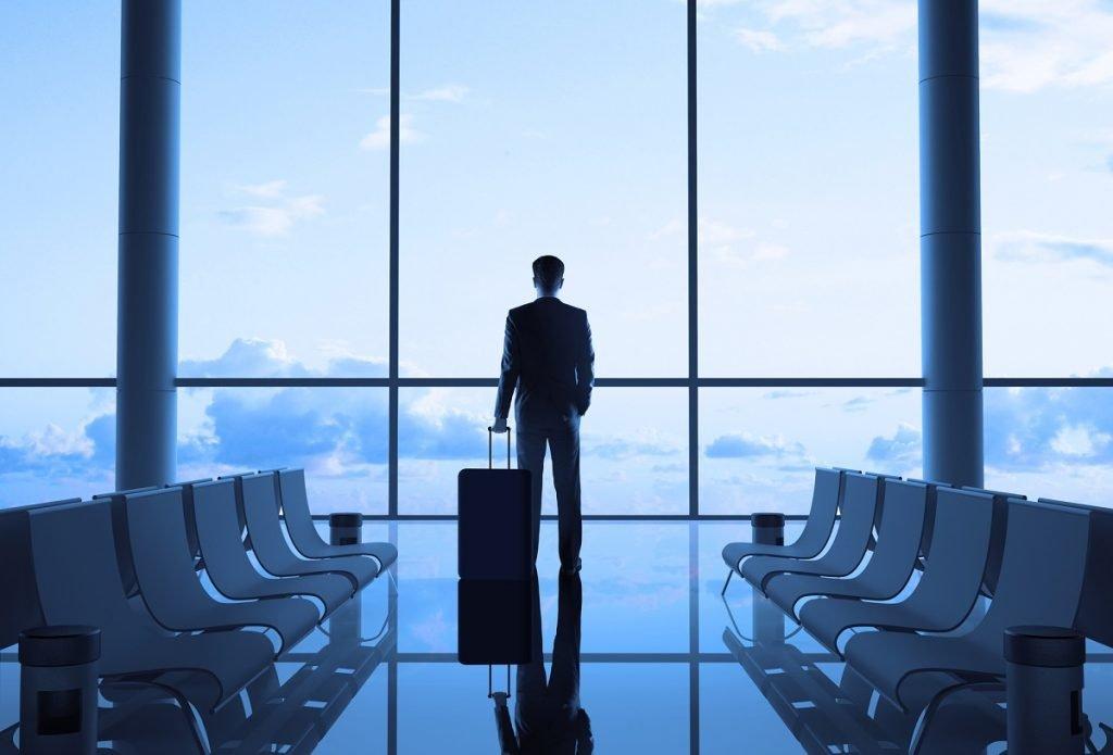 "A businessperson in an airport. <a href=""http://dep.ph/v/3py5p1-bsat0"" target=""_blank"">Photo via Deposit Photos</a>"