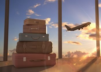 Travel bags and an airplane. Illustrative. Deposit Photos
