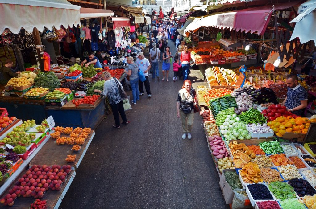 Shoppers at Shuk HaCarmel in Tel Aviv