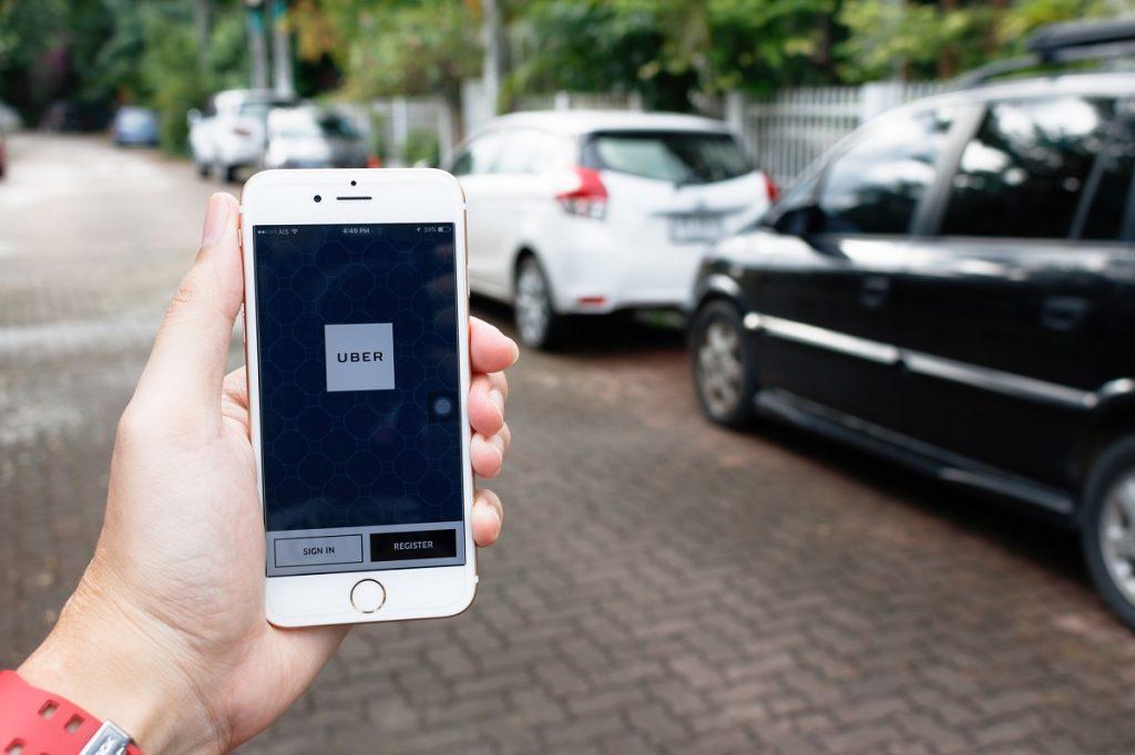 Uber app. Deposit Photos