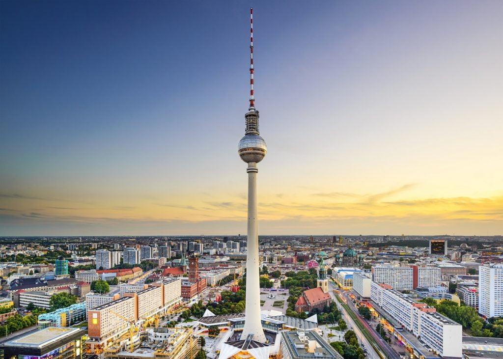 """Berlin city skyline at Alexanderplatz. <a href=""""https://depositphotos.com/stock-photos/berlin.html?qview=58358399"""" rel=""""noopener noreferrer"""" srcset="""