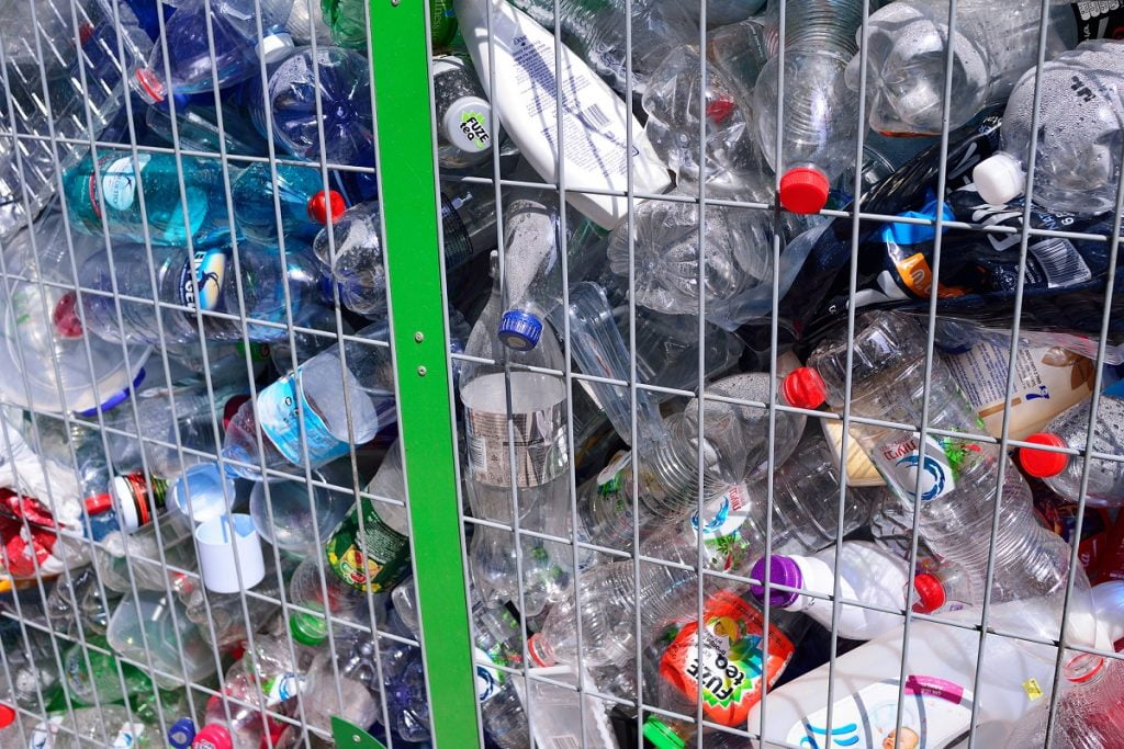 Containers for the disposal of plastic bottles in Tel Aviv. Deposit Photos