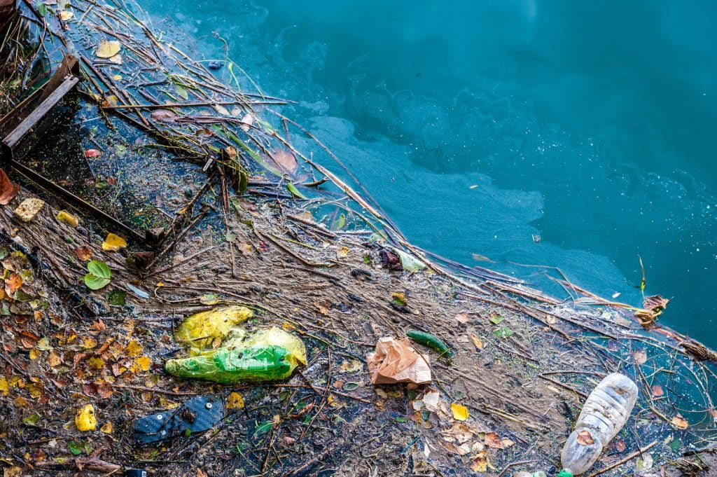 Water pollution on a river surface. Deposit Photos
